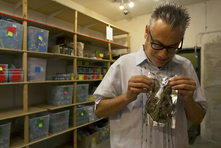"Andrew DeAngelo examines an ounce of high-grade medical cannabis on, ""Weed Wars,"" airing on the Discovery Channel. Photo: Discovery Channel"