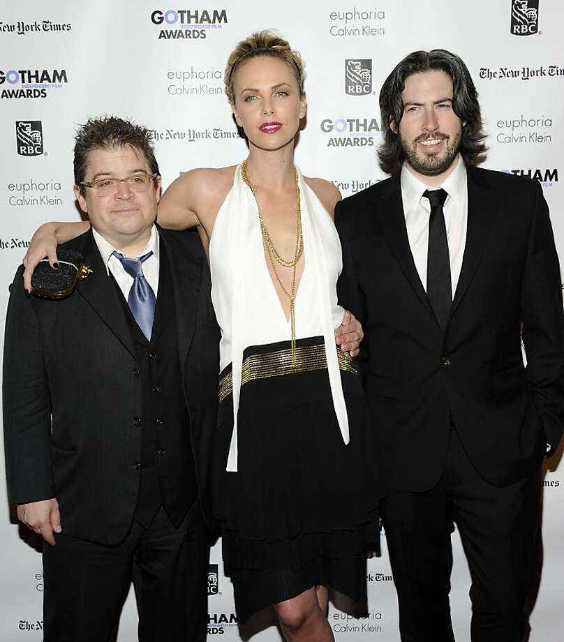 Actor Patton Oswalt, left, actress Charlize Theron and director Jason Reitman attend the IFP's 21st Annual Gotham Independent Film Awards at Cipriani Wall Street on Monday, Nov. 28, 2011 in New York. (AP Photo/Evan Agostini) Photo: Evan Agostini, AP