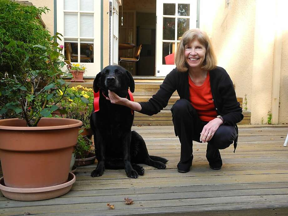 Mary Montali loves taking Joy, her black Labrador retriever, to Stinson Beach. Photo: Dennis Montali