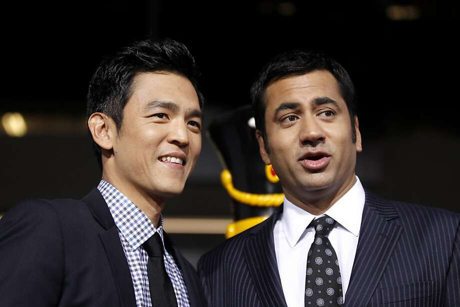 cast members kal penn right and john cho pose together at the premiere of - A Very Harold Kumar 3d Christmas Cast