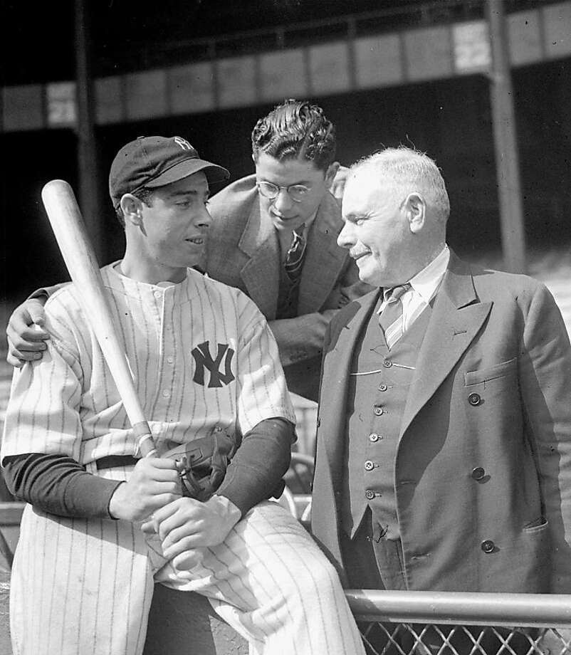 FILE--Joe DiMaggio, New York Yankees center fielder and 1937 home run hitting champ of major league baseball, has the moral support of his brother, Dominic DiMaggio, center,  and his father, Joe DiMaggio, Sr., right, for the World Series battle with the New York Giants opening in this Oct. 1937.  DiMaggio, the elegant Yankee Clipper whose 56-game hitting streak endures as one of the most remarkable records in baseball or any sport, died Monday, March 8, 1999 at his home in Hollywood, Fla. He was 84.(APPhoto/File )  Ran on: 08-28-2011 In 1936, Dominic DiMaggio (right) decided to try following big brother Joe into pro baseball. Photo: Associated Press