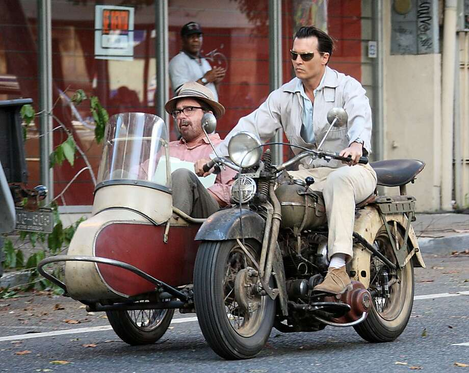 "Johnny Depp (right, with Michael Rispoli) plays a journalist working for a run-down Caribbean newspaper in ""The Rum Diary,"" based on the Hunter S. Thompson novel. IMAGE ID # 2105688 Exclusive...Johnny Depp and co-star Michael Rispoli film scenes for their new movie, ""The Rum Diary,"" around San Juan, Puerto Rico on April 16, 2009. Depp drove around, looking classic cool on a vintage motorbike, while Rispoli smoked a cigar in the sidecar. 04/16/2009 --- Michael Rispoli, Johnny Depp --- (C) 2009 Fame Pictures, Inc. - Santa Monica, CA, U.S.A - 310-395-0500 / Sales: 310-395-0500 Photo: FilmDistrict"