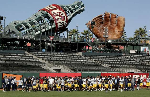 Players wrap up practice for the day, as the California Golden Bears football team holds their first practice at AT&T Park, on Tuesday August 16, 2011, in San Francisco, Ca. AT&T Park will their home field while Memorial Stadium on the UC Berkeley campus is being rebuilt. Photo: Michael Macor, The Chronicle