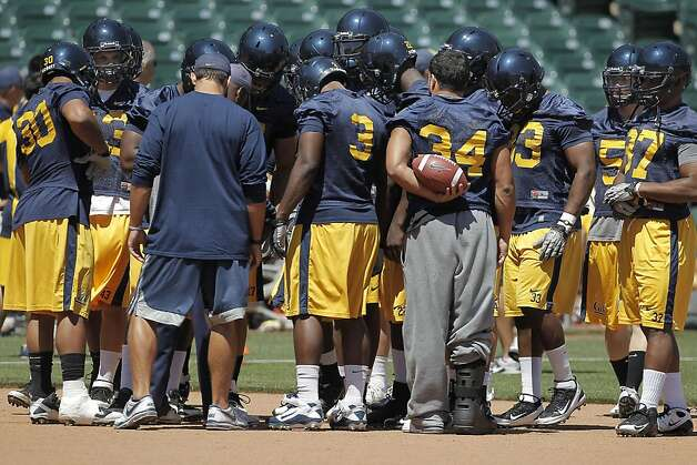 Defensive backs huddle up, as the California Golden Bears football team holds their first practice at AT&T Park, on Tuesday August 16, 2011, in San Francisco, Ca. AT&T Park will their home field while Memorial Stadium on the UC Berkeley campus is being rebuilt. Photo: Michael Macor, The Chronicle