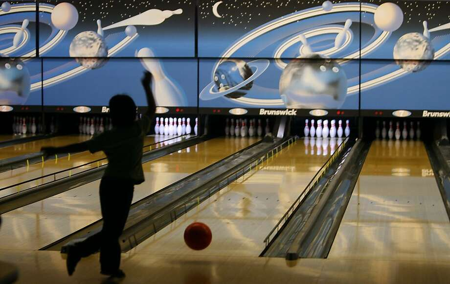 A young bowler shoots for a strike at the Presidio Bowling Center in San Francisco, Calif. on Friday, August 5, 2011. Photo: Paul Chinn, The Chronicle