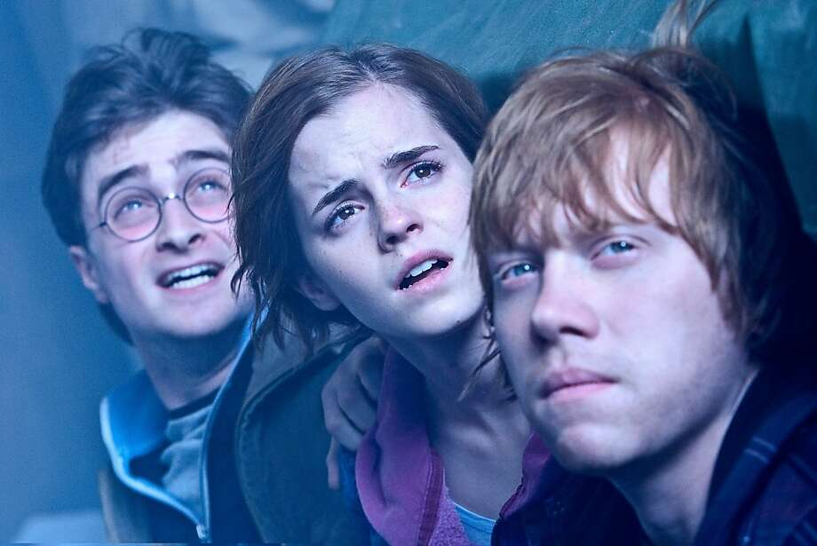 """DANIEL RADCLIFFE as Harry Potter, EMMA WATSON as Hermione Granger and RUPERT GRINT as Ron Weasley in Warner Bros. Pictures' fantasy adventure """"HARRY POTTER AND THE DEATHLY HALLOWS - PART 2,"""" a Warner Bros. Pictures release.  Photo by Jaap Buitendijk (L-r) DANIEL RADCLIFFE as Harry Potter, EMMA WATSON as Hermione Granger and RUPERT GRINT as Ron Weasley in Warner Bros. Pictures' fantasy adventure """"HARRY POTTER AND THE DEATHLY HALLOWS – PART 2,"""" a Warner Bros. Pictures release. Photo: Jaap Buitendijk, Warner Bros."""