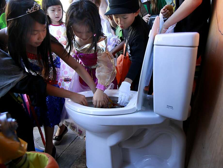 What better receptacle for Halloween candy then the modern toilet at A. Valente and Sons Plumbing store on Union Street.  Students at Sherman Elementary School in San Francisco, Calif. got to trick or treat early Monday as merchants welcomed them on Union Street. Ran on: 11-01-2011 Photo caption Dummy text goes here. Dummy text goes here. Dummy text goes here. Dummy text goes here. Dummy text goes here. Dummy text goes here. Dummy text goes here. Dummy text goes here.###Photo: halloween01_ph11319932800SFC###Live Caption:What better receptacle for Halloween candy then the modern toilet at A. Valente and Sons Plumbing store on Union Street.  Students at Sherman Elementary School in San Francisco, Calif. got to trick or treat early Monday as merchants welcomed them on Union Street.###Caption History:What better receptacle for Halloween candy then the modern toilet at A. Valente and Sons Plumbing store on Union Street.  Students at Sherman Elementary School in San Francisco, Calif. got to trick or treat early Monday as merchants welcomed them on Union Street.###Notes:Brant Ward, 415.606.3744###Special Instructions:**MANDATORY CREDIT FOR PHOTOG AND SF CHRONICLE-NO SALES-MAGS OUT-TV OUT-INTERNET: AP MEMBER NEWSPAPERS ONLY** Photo: Brant Ward, The Chronicle
