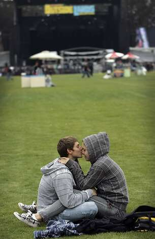 "Anthony Scopelli, left, of Santa Barbara, and girlfriend Rosalie Imler, of Berkeley, cuddle on the first day of Outside Lands Music and Art Festival in Golden Gate Park in San Francisco, Calif., August 12, 2011.   ""It's too loud for me right by the state, so we're trying to find the perfect medium,"" Imler said. Photo: Sarah Rice, Special To The Chronicle"