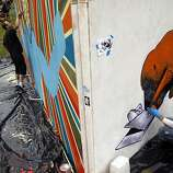Artists Skinner, left, of Sacramento, and Nate Van Dyke, right, of San Francisco, paint at the Juxtapoz live painting event at Outside Lands Music and Art Festival in Golden Gate Park in San Francisco, Calif., August 12, 2011.  Artists will create panels each day that will then be displayed around the festival grounds.