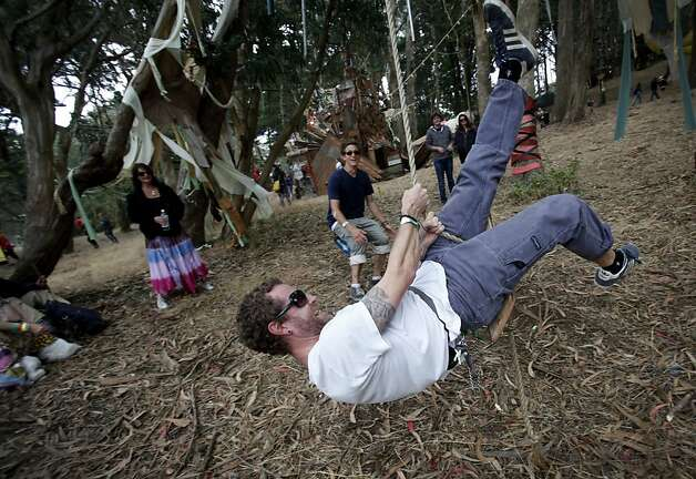 Nathan Woody, of San Francisco, rides a rope swing that plays a giant wind chime at Outside Lands Music and Art Festival in Golden Gate Park in San Francisco, Calif., August 12, 2011. Photo: Sarah Rice, Special To The Chronicle