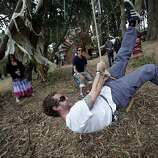 Nathan Woody, of San Francisco, rides a rope swing that plays a giant wind chime at Outside Lands Music and Art Festival in Golden Gate Park in San Francisco, Calif., August 12, 2011.