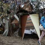 Aurelia Aleman, of Spain, runs out from one of the art projects installed in the forest at Outside Lands Music and Art Festival in Golden Gate Park in San Francisco, Calif., August 12, 2011.   Ran on: 08-13-2011 Aurelia Aleman of Spain runs out from one of the art installations featured at the art and music festival. In addition to art, variety acts are featured at the Barbary stage. Ran on: 08-13-2011 Aurelia Aleman of Spain runs out from one of the art installations featured at the art and music festival. In addition to art, variety acts are featured at the Barbary stage.