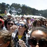 Henry Allison, of Los Altos, blows bubbles while waiting for a band to start at Outside Lands Music and Art Festival in Golden Gate Park in San Francisco, Calif., August 14, 2011.