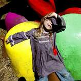 Miel Lappin, 4, of San Francisco, plays on the giant gumdrops in Choco Lands, an area in the woods filled with sugary vendors and candy-themed decorations, at Outside Lands Music and Art Festival in Golden Gate Park in San Francisco, Calif., August 14, 2011.