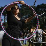 Esther Paek dances to the rhythm of STRFKR's music with her hula-hoops at Golden Gate Park for the 2011 Outside Lands Music Festival in San Francisco Calif.,  on August 13, 2011.