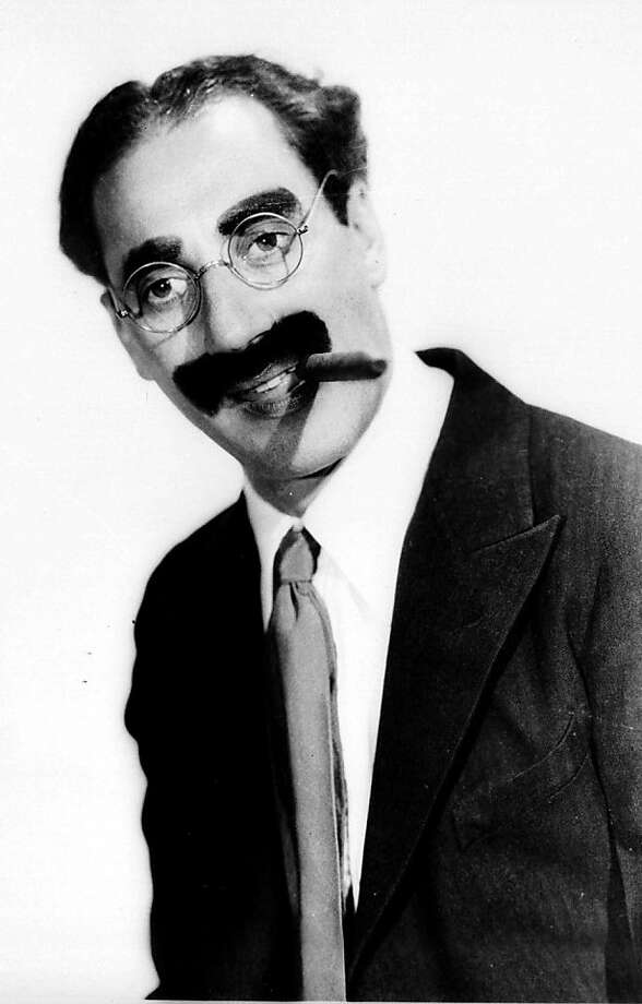 FILE--Comedian Groucho Marx is shown in this 1933 handout photo. Marx, who did more than smoke cigars and leer at women, was also a defender of free speech and U.S.-Soviet friendship. Documents recently made public show the FBI kept detailed files on the comedian, ranging from his supportive quote about the Scottsboro Boys in the 1930s to jokes made on television in the '50s and '60s. (AP Photo/Paramount) Ran on: 12-22-2008 Photo: Paramount, AP