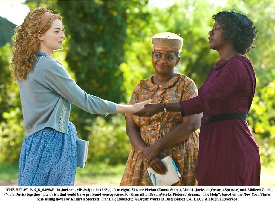 """In Jackson, Mississippi in 1963, (left to right) Skeeter Phelan (Emma Stone), Minnie Jackson (Octavia Spencer) and Aibileen Clark (Viola Davis) together take a risk that could have profound consequences for them all in """"The Help."""" """"THE HELP""""  946_D_08558R  In Jackson, Mississippi in 1963, (left to right) Skeeter Phelan (Emma Stone), Minnie Jackson (Octavia Spencer) and Aibileen Clark (Viola Davis) together take a risk that could have profound consequences for them all in DreamWorks Pictures' drama, """"The Help"""", based on the New York Times best-selling novel by Kathryn Stockett.  Ph: Dale Robinette  ©DreamWorks II Distribution Co., LLC. ÊAll Rights Reserved. Photo: Disney 2011"""