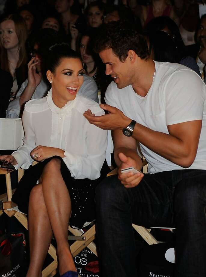 NEW YORK, NY - SEPTEMBER 12: (L-R) Kim Kardashian, and Kris Humphries attend the Abbey Dawn by Avril Lavigne Spring 2012 fashion show during Style360 at the Metropolitan Pavilion on September 12, 2011 in New York City.  (Photo by Ilya S. Savenok/Getty Images) Photo: Ilya S. Savenok, Getty Images