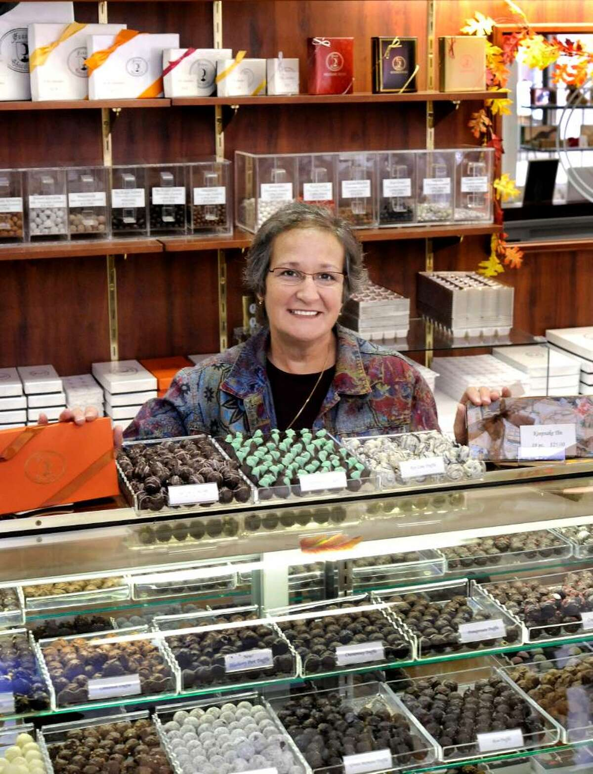 Lucille Hauser,Hauser Chocolatier store owner, in the Bethel shop on Wednesday, Oct.14,2009.