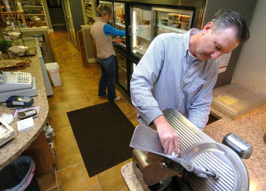 Steve and Sue Eskierski, of Villarina Pasta store in New Milford and Southbury, works at the store Wednesday, Oct. 21, 2009. Photo: Chris Ware / The News-Times