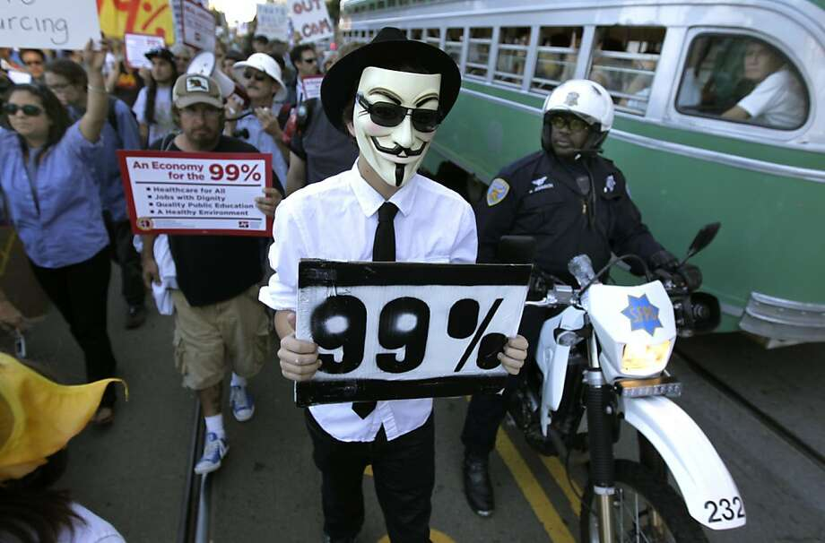 Occupy SF protesters, many dressed in costumes, gather for a Halloween march past Justin Herman Herman Plaza on Steuart Street in San Francisco, Calif. on Saturday, Oct. 29, 2011. Photo: Paul Chinn, The Chronicle