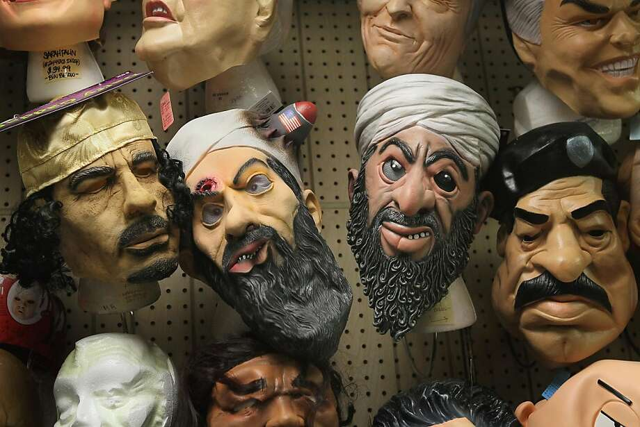 CHICAGO, IL - OCTOBER 28:  Halloween masks of Muammar Gaddafi, Osama bin Laden, and Saddam Hussein are offered for sale at Fantasy Costumes on October 28, 2011 in Chicago, Illinois.  The store, which had long lines at the registers at 4 AM this morning, is open around the clock through Halloween to help keep up with customer demand. Retailers nationwide are expecting record sales for Halloween merchandise this year with shoppers spending close to $7 billion dollars to celebrate the holiday.  (Photo by Scott Olson/Getty Images) Photo: Scott Olson, Getty Images