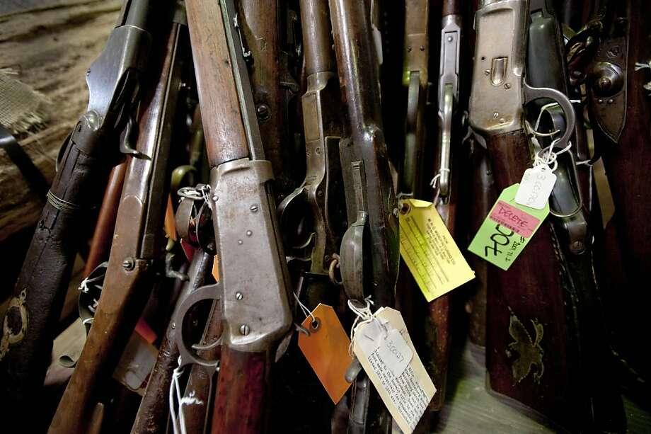 Antique rifles sit in storage at the waste-to-energy plant in Harrisburg, Pennsylvania, U.S., on Friday, Oct. 28, 2011. Harrisburg, Pennsylvania's capital, plans to auction off more than 8,000 relics ranging from 1900s-era rifles to wooden wagons that were meant to be part of a Wild West museum in the bankrupt city in the Northeast. Photographer: Paul Taggart/Bloomberg Photo: Paul Taggart, Bloomberg