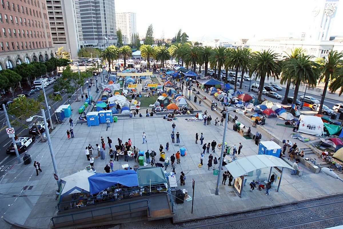 Members of Occupy San Francisco continue their protests in Justin Herman Plaza in San Francisco, Calif., on Sunday, Oct. 30, 2011. Ran on: 10-31-2011 Harry Bridges Plaza, built on space opened by the removal of the elevated Embarcadero Freeway in 1991, has become a campsite for Occupy SF demonstrators.