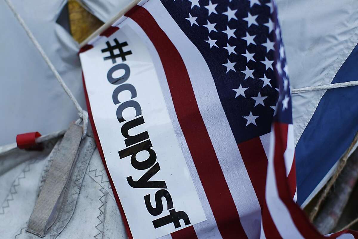 An American flag is seen on a tent in Occupy San Francisco's camping ground at Justin Herman Plaza in San Francisco, Calif. Friday, October 28, 2011.