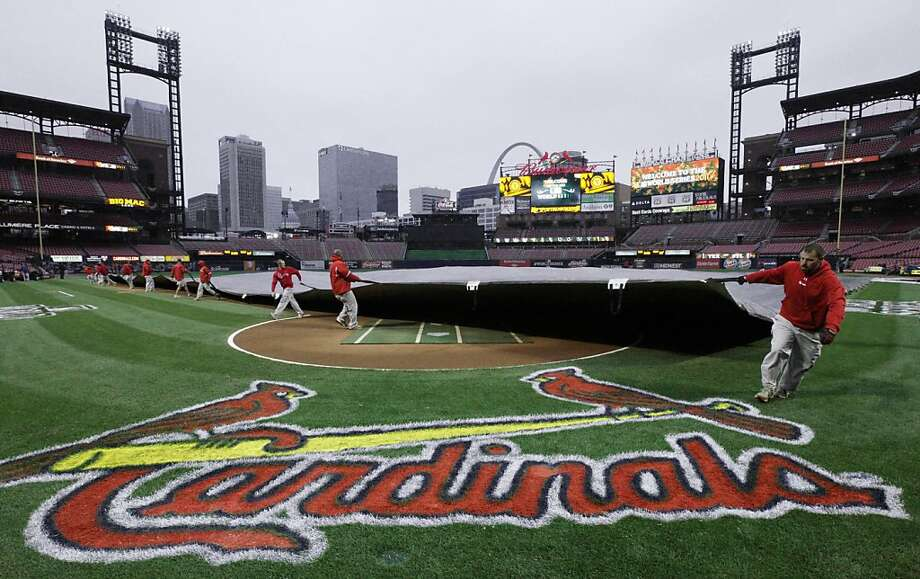 Workers put a tarp on the infield at Busch Stadium Wednesday, Oct. 26, 2011, in St. Louis, after officials announced that Game 6 of baseball's World Series is postponed due to rain. (AP Photo/Paul Sancya)  Ran on: 10-27-2011 Wednesday's rainout means St. Louis' Chris Carpenter gets another day of rest for a possible Game 7 start. Ran on: 10-27-2011 Wednesday's rainout means St. Louis' Chris Carpenter gets another day of rest for a possible Game 7 start. Ran on: 10-27-2011 Wednesday's rainout means St. Louis' Chris Carpenter gets another day of rest for a possible Game 7 start. Photo: Paul Sancya, AP