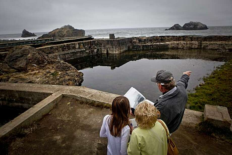 Tom Bratton gives a brief history of the Sutro Baths to Joan Walker of Redwood Shores and her granddaughter, Cassie, on Friday, July 9, 2010 in San Francisco, Calif. Photo: Russell Yip, The Chronicle