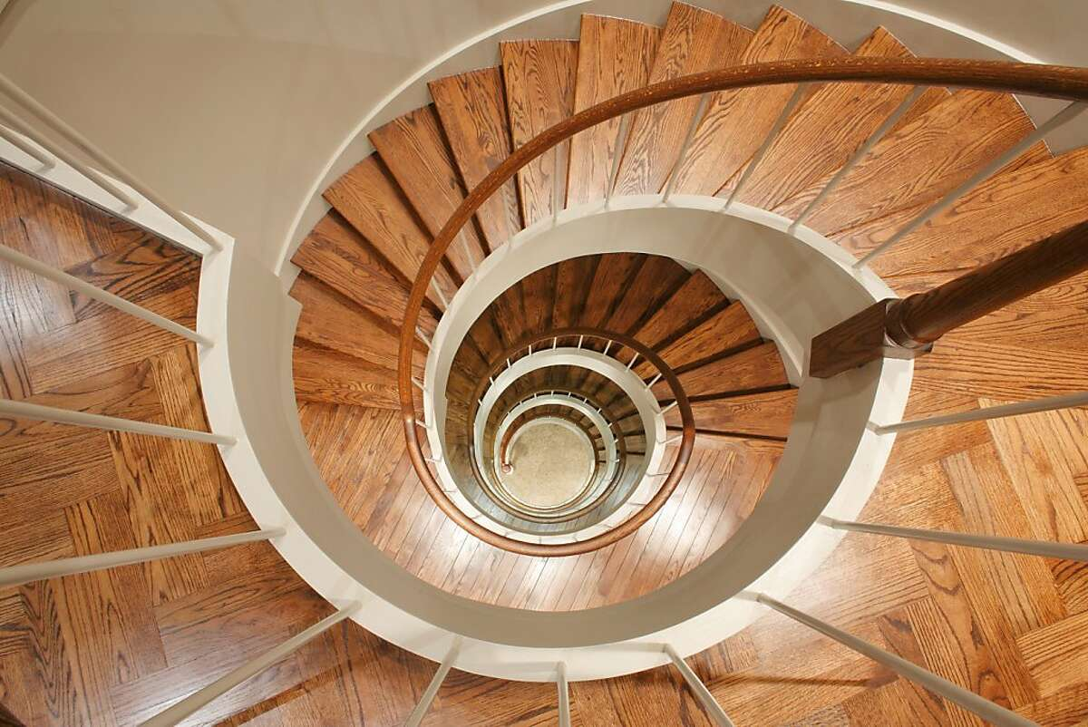 Reminiscent of a nautilus, the custom staircase whorls down all five floors for 1400 Montgomery St.