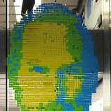 The face of Apple co-founder and former CEO Steve Jobs is created with adhesive notes on the window of an Apple Store in Munich on October 18, 2011. Millions of people paid emotional tribute to Jobs, since he died on October 5, 2011 at the age of 56 after a years-long battle with cancer.