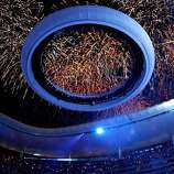 GUADALAJARA, MEXICO - OCTOBER 14:  A general view as spectators hold up colored lights as fireworks erupt during the Opening Ceremony for the XVI Pan American Games at Omnilife Stadium on October 14, 2011 in Guadalajara, Mexico.  (Photo by Mike Ehrmann/Getty Images)