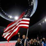 GUADALAJARA, MEXICO - OCTOBER 14:  Olympic gold medalist Jason Read carries the flag for Team USA during the Opening Ceremony for the XVI Pan American Games at Omnilife Stadium on October 14, 2011 in Guadalajara, Mexico.  (Photo by Mike Ehrmann/Getty Images)