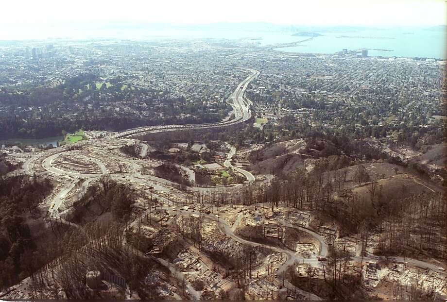 OAKHILLSFIRE10-23OCT1991-BW - Aerials of the burned out areas of the Oakland Hills Fire that destroyed hundreds of homes.  one lone surving house stands on the Hill Top.  Photo by Brant Ward Photo: Brant Ward, The Chronicle