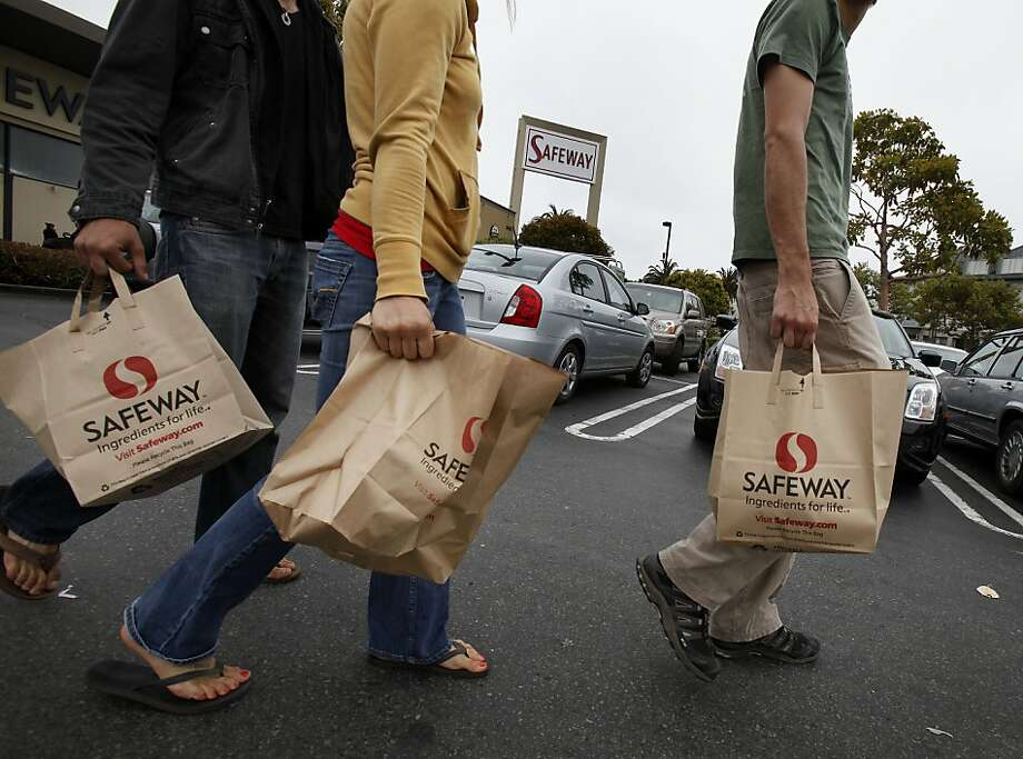Three Safeway shoppers at the Market Street store headed across the parking lot with their shopping bags unaware of plans to charge for paper and plastic Monday August 2, 2010. They said they use the bags for recycling.  San Francisco Supervisor Ross Mirkarimi and others want to begin charging shoppers for the use of paper and plastic bags.   Ran on: 08-03-2010 Shoppers leave the Safeway on Market Street. A state bill would impose a minimum 5-cent charge on paper bags. Ran on: 08-04-2010 Shoppers who don't bring a bag soon may face a fee.  Ran on: 11-30-2010 San Francisco's proposal to charge shoppers a fee for using paper bags might be in jeopardy under Proposition 26. Photo: Brant Ward, The Chronicle