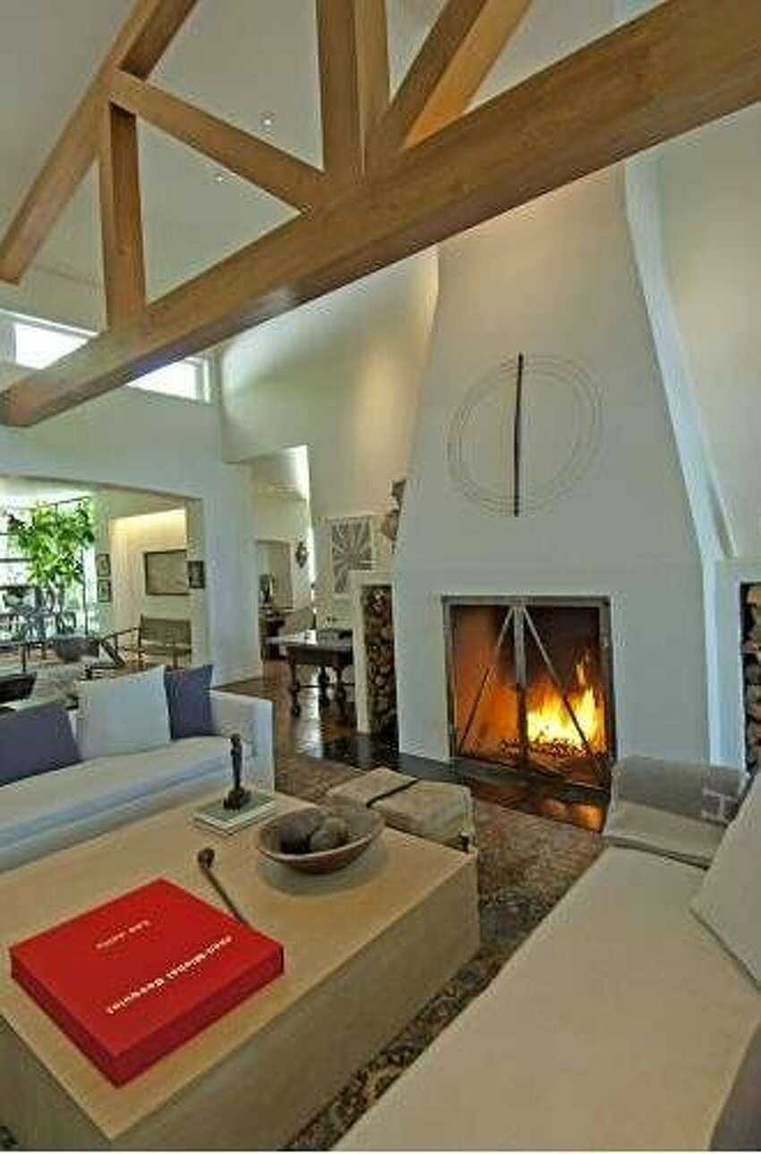 Stepping inside the living room, with its high ceilings and fireplace.
