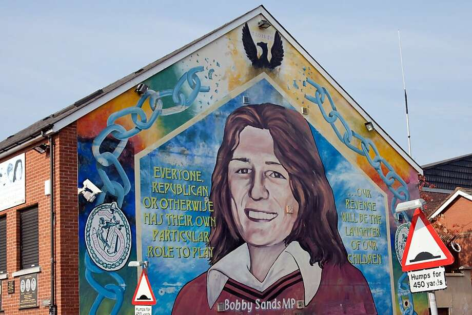 A visit to Belfast isn't complete without viewing its colorful political murals. This one, in the Falls Road neighborhood, commemorates IRA hunger-striker Bobby Sands. Photo: Dominic Bonuccelli, Azf