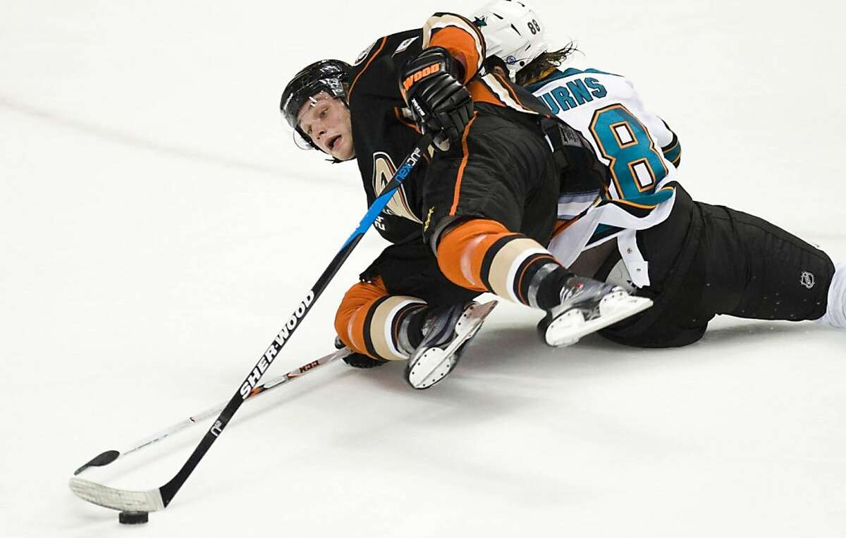 Anaheim Ducks' Bobby Ryan gets taken down by San Jose Sharks' Brent Burns, right, at the Honda Center in Anaheim, California, on Friday, October 14, 2011. (Michael Goulding/Orange County Register/MCT)