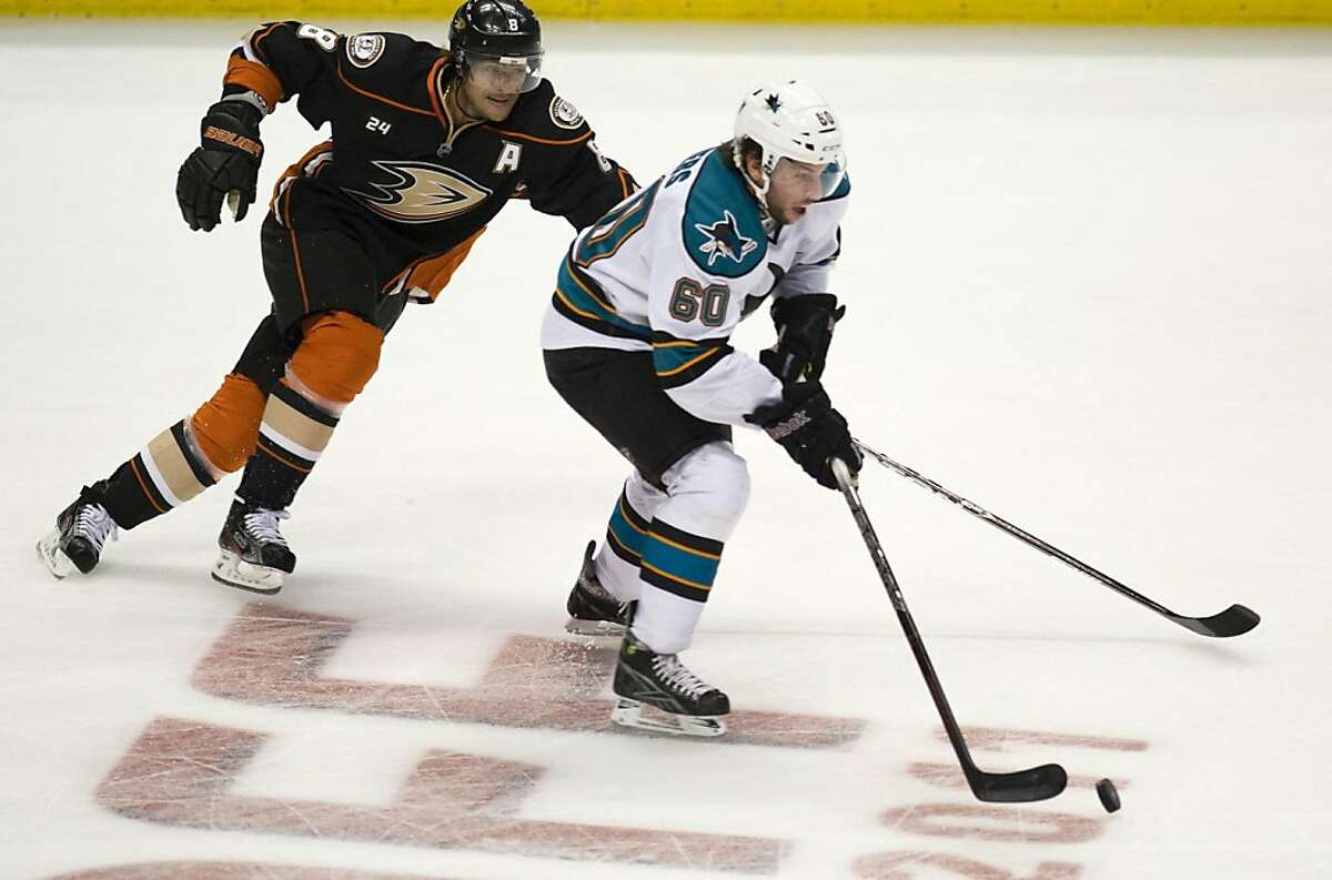 San Jose Sharks' Jason Demers works up ice with Teemu Selanne of the Anaheim Ducks giving chase at the Honda Center in Anaheim, California, on Friday, October 14, 2011. (Michael Goulding/Orange County Register/MCT)