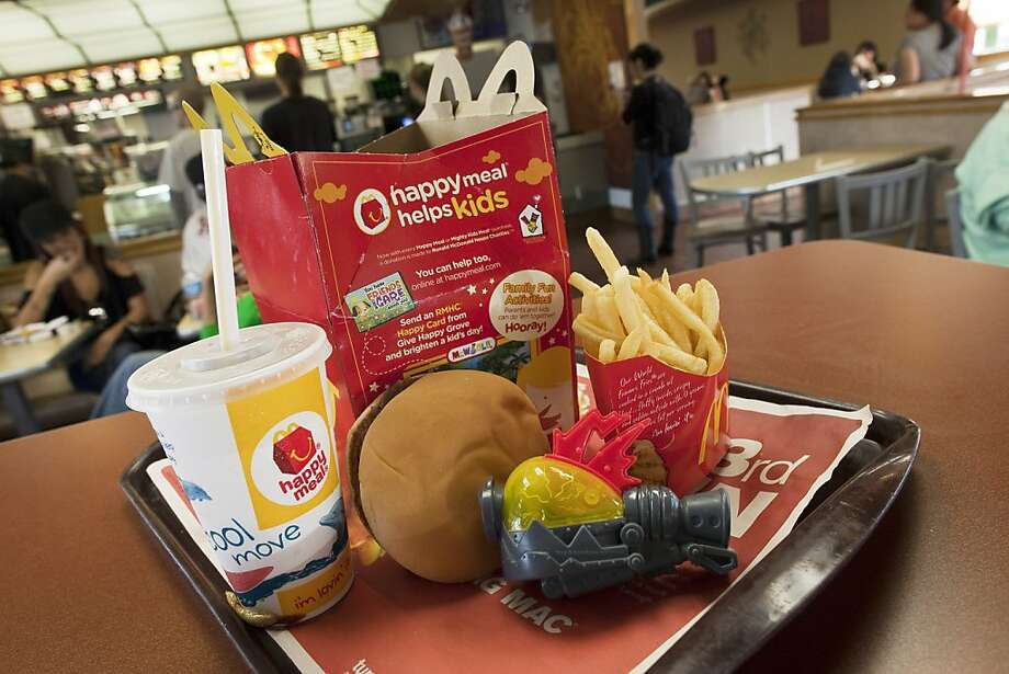 SAN FRANCISCO, CA - NOVEMBER 3: (FILE PHOTO)  A photo illustration of a Happy Meal at McDonald's on November 3, 2010 in San Francisco, California.  McDonald's announced a new reduced calorie Happy Meal on July 26, 2011 that would include a fruit and vegetable with every meal and reduce the portion size of the french fries.  (Photo by David Paul Morris/Getty Images)  Ran on: 07-28-2011 Photo caption Dummy text goes here. Dummy text goes here. Dummy text goes here. Dummy text goes here. Dummy text goes here. Dummy text goes here. Dummy text goes here. Dummy text goes here.###Photo: edit28_happymeals_PH1311465600Getty Images North America###Live Caption:SAN FRANCISCO, CA - NOVEMBER 3: (FILE PHOTO)  A photo illustration of a Happy Meal at McDonald's on November 3, 2010 in San Francisco, California.  McDonald's announced a new reduced calorie Happy Meal on July 26, 2011 that would include a fruit and vegetable with every meal and reduce the portion size of the french fries.###Caption History:SAN FRANCISCO, CA - NOVEMBER 3: (FILE PHOTO)  A photo illustration of a Happy Meal at McDonald's on November 3, 2010 in San Francisco, California.  McDonald's announced a new reduced calorie Happy Meal on July 26, 2011 that would include a fruit and vegetable with every meal and reduce the portion size of the french fries.  (Photo by David Paul Morris-Getty Images)###Notes:FILE:McDonald's To Introduce Healthier Kids' Happy Meal###Special Instructions:(FILE PHOTO) Photo: David Paul Morris, Getty Images