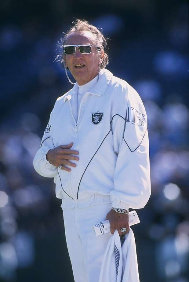OAKLAND, CA- 1996:  Owner and President Al Davis of the Oakland Raiders stands in attention as he salutes the American Flag during the singing of the National Anthem before the Raiders 37-21 victory over the Lions at Alameda County Coliseum in Oakland, California  Davis the long time owner of the Oakland Raiders was reported as passed away on the teams website.  (Photo by Otto Greule Jr/Getty Images) Photo: Otto Greule Jr, Getty Images