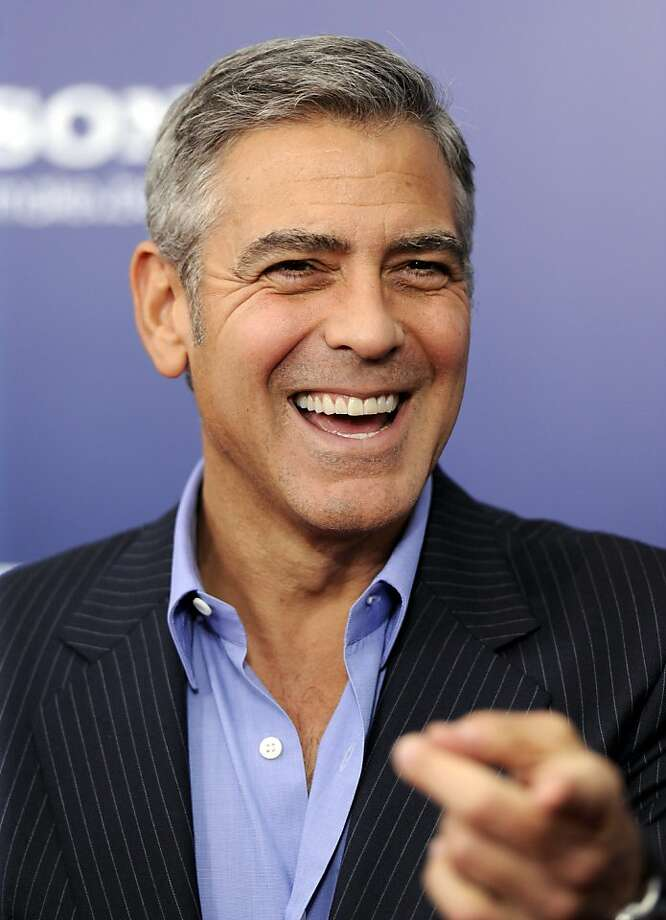 "Director and actor George Clooney attends the premiere of ""Ides of March"" at the Ziegfeld Theatre on Wednesday, Oct. 5, 2011 in New York. (AP Photo/Evan Agostini) Photo: Evan Agostini, AP"