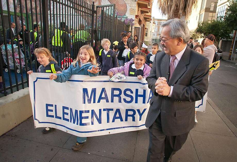 San Francisco Mayor Ed Lee leads school children on their walk from Kidpower Park to Marshall School on International Walk to School Day in San Francisco, Calif., on Wednesday, October 5, 2011. Ran on: 10-06-2011 On International Walk to School Day, San Francisco Mayor Ed Lee accompanies children in the Mission District walking from KidPower Park to Marshall Elementary School on Wednesday. Photo: John Storey, Special To The Chronicle
