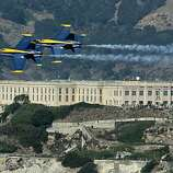 Two U.S. Navy Blue Angels F/A-18 Hornets fly over Alcatraz Island on October 7, 2010 in San Francisco, California. The U.S. Navy Blue Angels started practice ahead of Fleet Week which begins Saturday with the parade of ships and an air show.