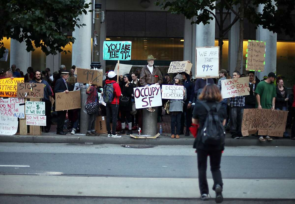 Protesters with the group Occupy SF organize outside of the Federal Reserve Bank in San Francisco, CALIF on Oct. 7, 2011.