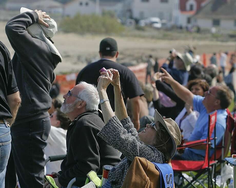 People shoot pictures of the Air Show over the bay during Fleet week in San Francisco, Calif., on Saturday, October 8, 2011. Photo: John Storey, Special To The Chronicle