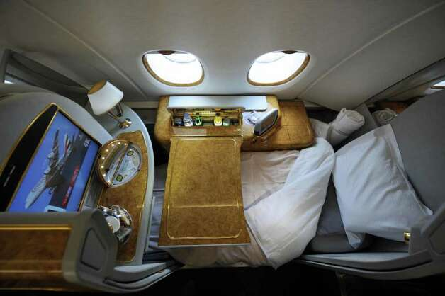 A first class seat configured for sleeping aboard an Emirates Airlines A380 on August 1, 2008