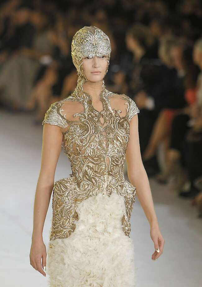 A model displays a creation by British fashion designer Sarah Burton for Alexander McQueen's spring-summer 2012 ready to wear collection presented, Tuesday, Oct. 4, 2011, in Paris. (AP Photo/Jacques Brinon) Photo: Jacques Brinon, AP